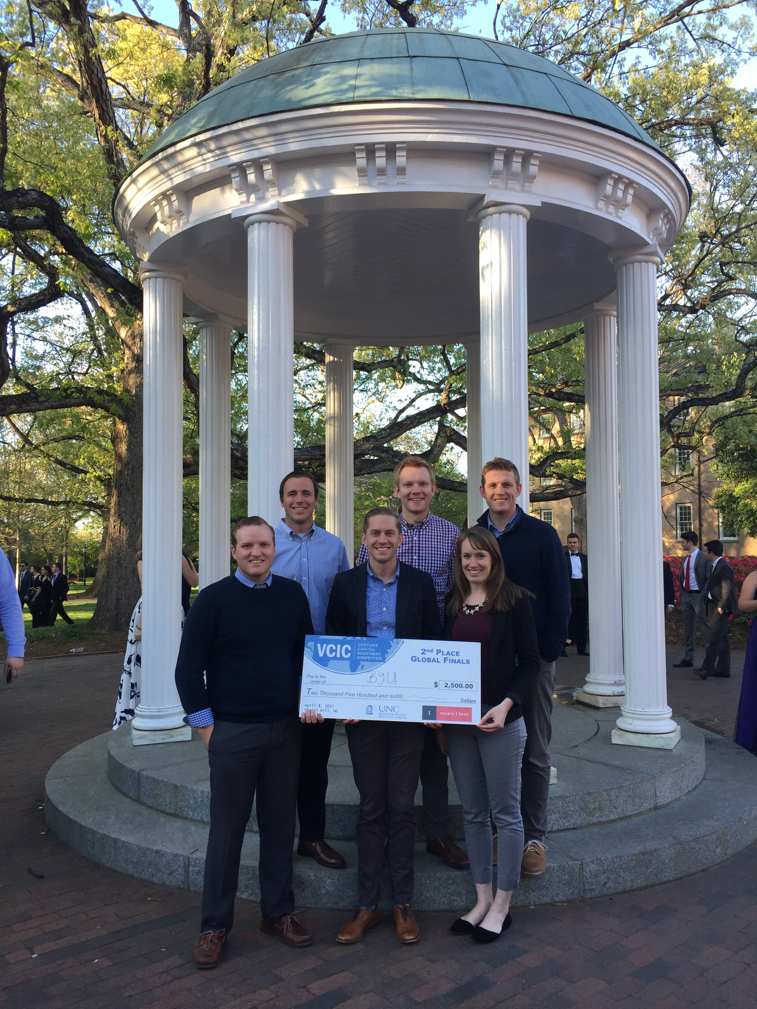 BYU MBA Team Members Pose With Their Winnings On The UNC Campus.