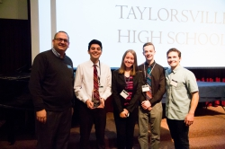 The winning team from Taylorsville High School poses with GMC director and the CEO of Thread Wallet.