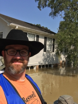 Accounting alum Jason Graham poses with his flooded house