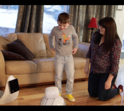 Nelli, the robot, with a child in his home.