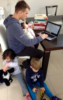 Villanova studying with his kids around him.