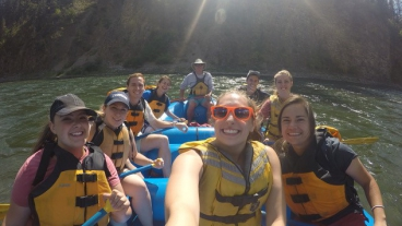 Group of students white water rafting