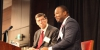 Clayton Christensen and Efosa Ojomo lecture at a conference.