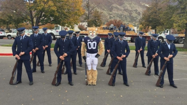 ROTC Air Force Honor Guard stands in formation with BYU Mascot Cosmo the Cougar