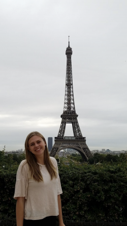 Melissa Nielsen stands in front of the Eiffel Towel in Paris
