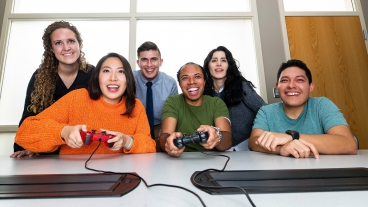Photo illustration of co-workers playing a team video game.