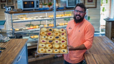 Ross Hruska holding pan of kolaches.