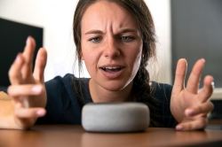 Woman yelling at smart speaker