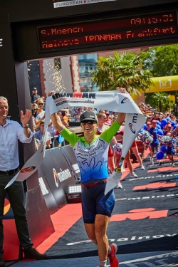 Moench crossing the finish line at the 2019 IRONMAN European Championship. Photo courtesy of James Mitchell.