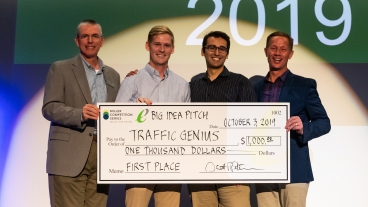 Bo Bleyl and Dakota Burrow on stage after winning first place at the Big Idea Competition.