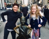 Sarah Agate and daughter in New York with statue