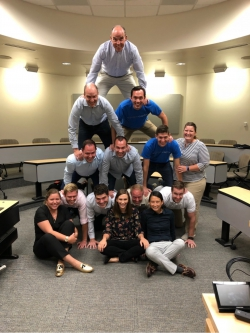 The 2019 cougar capital team forms a human pyramid
