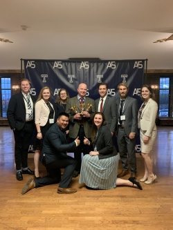 Meservy with a victorious BYU Marriott student team at the 2019 AIS conference. Photo courtesy of Tom Meservy.