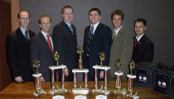 From L to R: Reed Olsen, Dave Wilson, Robert Mount, Devin Collier, Landon Cope and Bryce Clark stand with the awards they won at the competition.