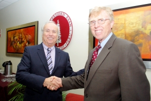 Jorge Talavera, president of ESAN University, and Lee Radebaugh, director of the Whitmore Center, seal the agreement between BYU and ESAN. The Escuela de Administración de Negocios in Lima, Peru, is one of the newest options offered by the GMC as an option for exchange students.