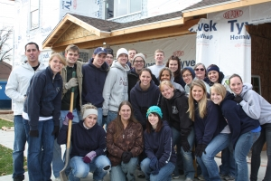 Around twenty accounting students helped build Mary Cisneros's (center) new home at a Habitat for Humanity event, sponsored by BYU's chapter of Beta Alpha Psi.