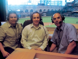 Finance student Chris Bernal sits in the press box with two announcers in Minute Maid Park during part of his internship with the Houston Astros.