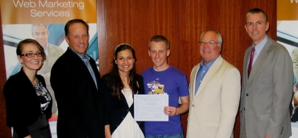 Saul Howard, winner of the Crexendo Website Competition, with judges from the Rollins Center and Crexendo