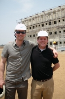 Lewis Hower (right), executive director of the University Impact Fund with Beau Seil (left), Ballard Center board member and a UIF adviser, on site at an affordable housing project in India.
