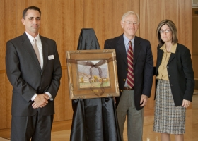 Francine Giani stands next to N. Dale Wright who presented her with a painting. David Hart, director of the Romney Institute, stands on the left. Giani was presented with the 2011 N. Dale Wright Distinguished Alumni Award at a luncheon last Friday.
