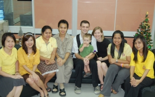 David Griffith, his wife Jade Grimmius and their son Ezra (center) with the business department staff at Chulalongkorn University in Bangkok, Thailand.