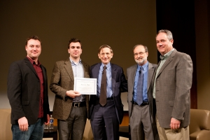 "From left: SSE co-directors Adam Norton and TJ Thomander receive the ""Award for Innovation in Social Entrepreneurship Education"" from Bill Drayton, Gregory Dees, with Todd Manwaring."